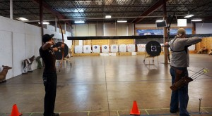 Customers test out some of No Limits' bows.