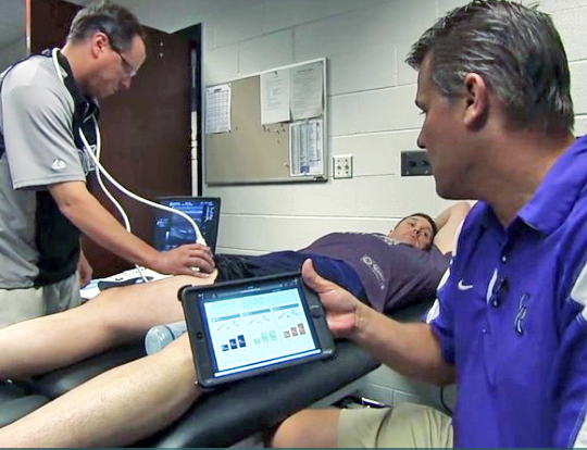 A Colorado Rockies trainer uses MuscleSound software to monitor an athlete's glycogen. Photo courtesy of MuscleSound.