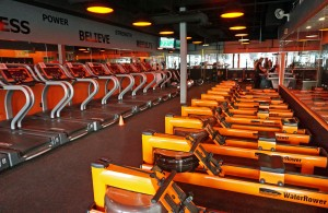 Orangetheory focuses on cardio-intensive workouts with rowing machines and treadmills.