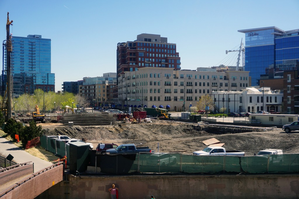 Crews work on the upcoming Confluence apartment building. Photo by Burl Rolett.