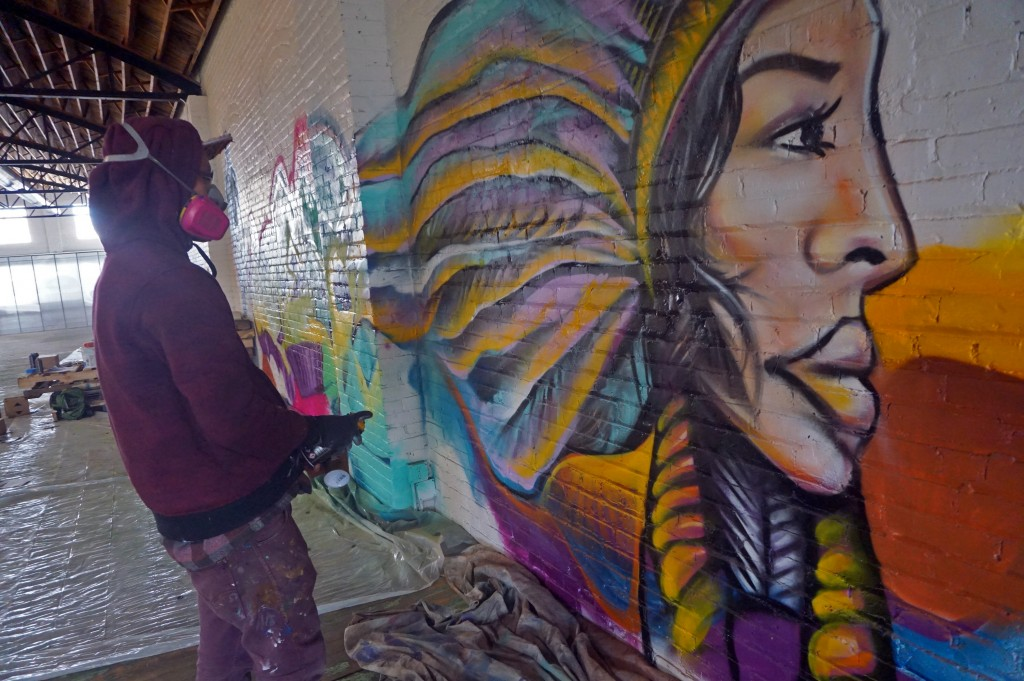 Artist decorate the walls of Ignitrr with spray paint. Photos by Burl Rolett.