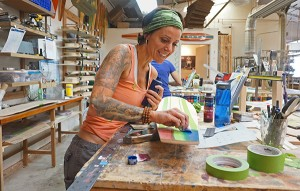 Heather Cleveland works on a board.