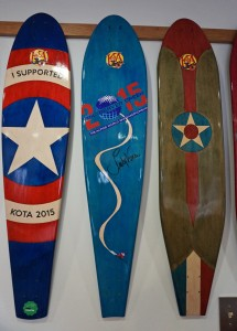KOTA designed a board for the Alpine Skiing World Championships in Vail (middle) signed by pro skier Lindsey Vonn.