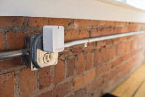 Sensors throughout the home send signals to a Wi-Fi connected plug-in that forwards messages to smartphones.