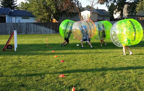 Bubble soccer players fight for the ball. Photos courtesy of Bump Soccer Denver.