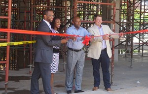 left to right: Albus Brooks, city councilman; Tracy Winchester, Executive Director of the Five Points Business District; Michael Hancock, mayor; Paul Books, developer.