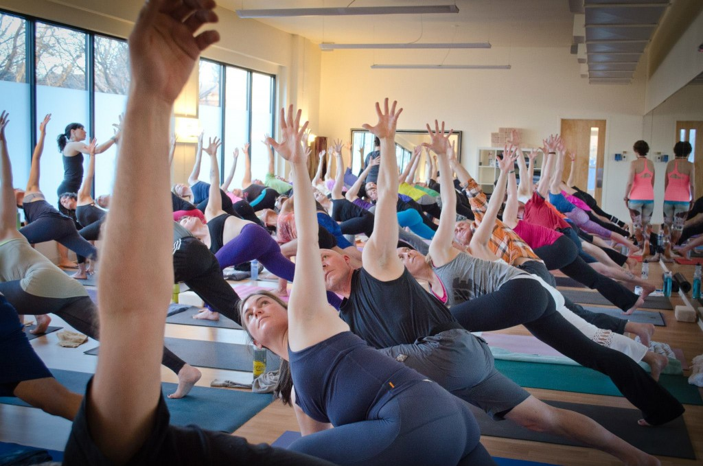 Yoga Pod students pack the Cherry Creek studio at an event last year. Photos courtesy of Yoga Pod.