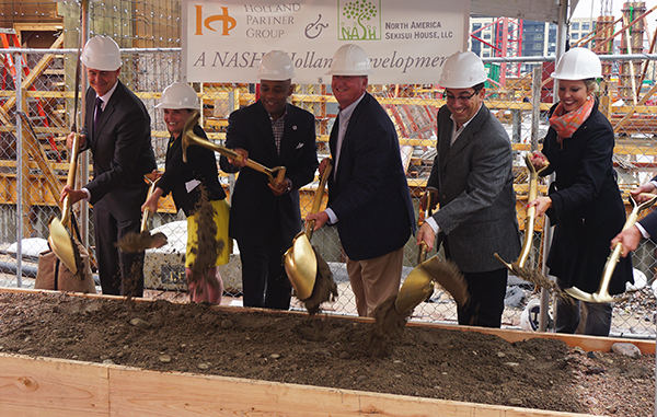 An apartment and retail project got its ceremonious start on Wednesday. Photos by Burl Rolett.