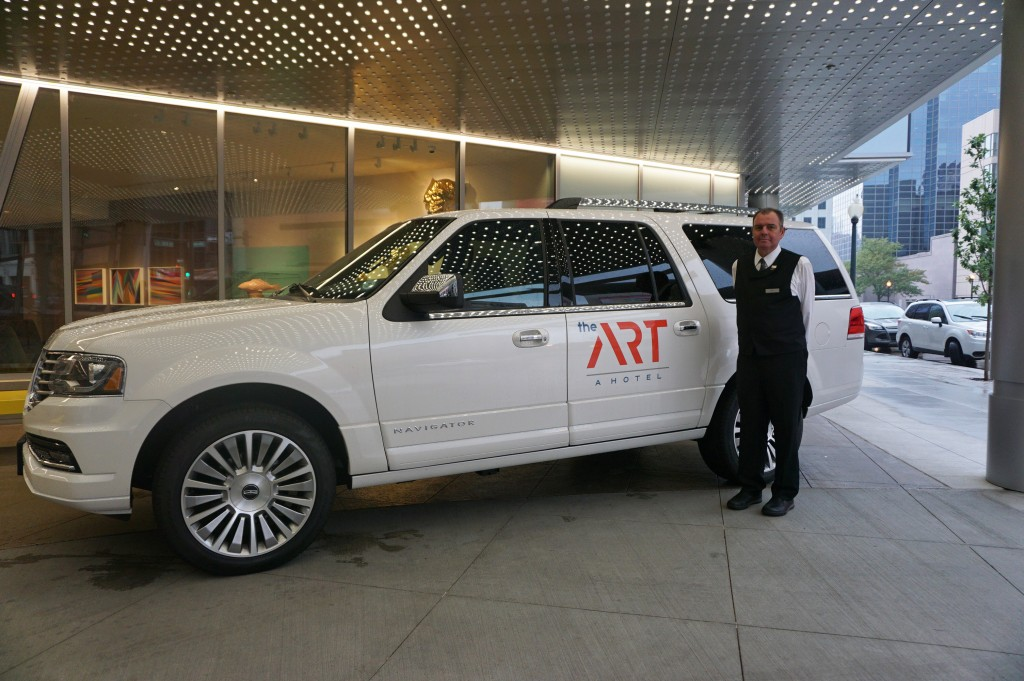 Driver Phil Semenchuk shuttles Art Hotel guests for free in a new Lincoln. Photo by George Demopoulos.