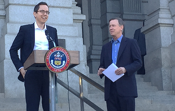 Reeves (left) with Gov. Hickenlooper at a Tuesday announcement. Photo by Katherine Blunt.