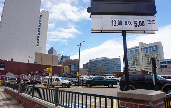 A hotel company plans to build over a downtown parking lot next door to another hotel tower. Photo by Burl Rolett.