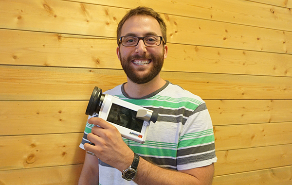 Gavin Anstey shows off his firm's camera-enhancing iPhone case. Photo by George Demopoulos.