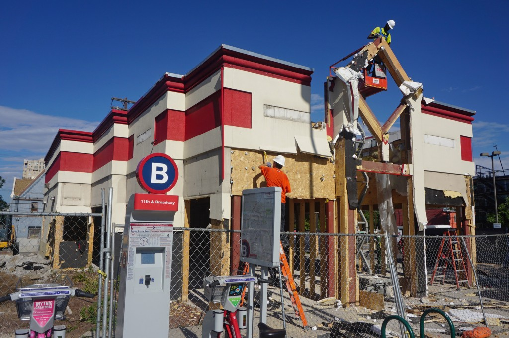 Crews tore down a former Arby's restaurant at 11th and Broadway. Photo by Burl Rolett.