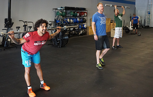 Ethan Goetz leads a class at the new CrossFit Wash Park gym. Photos by George Demopoulos.