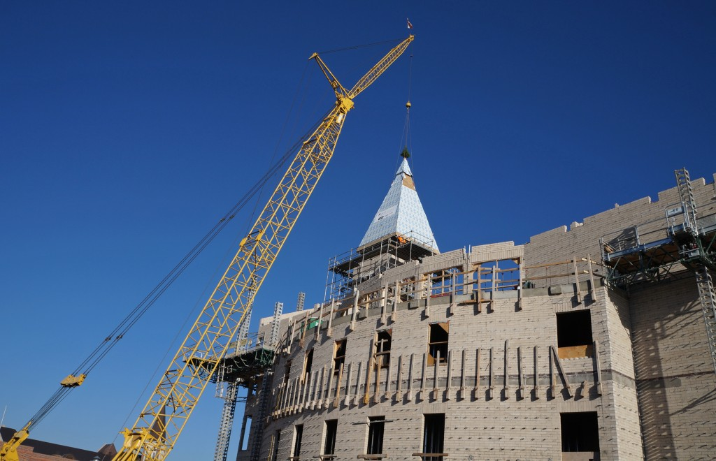 Crews lower a new spire into place atop a DU building. Photos by Amy DiPierro.