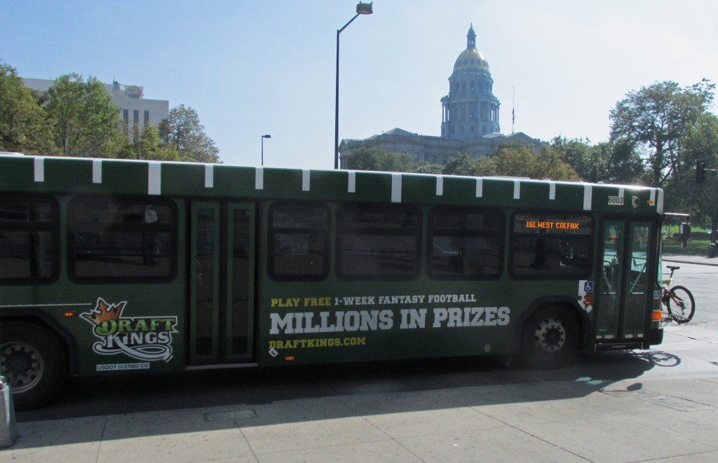 A DraftKings ad-plastered bus drives past the Capitol. Photo by Aaron Kremer.