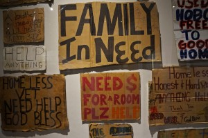 A museum curator collected signs from homeless people in the city for the display.
