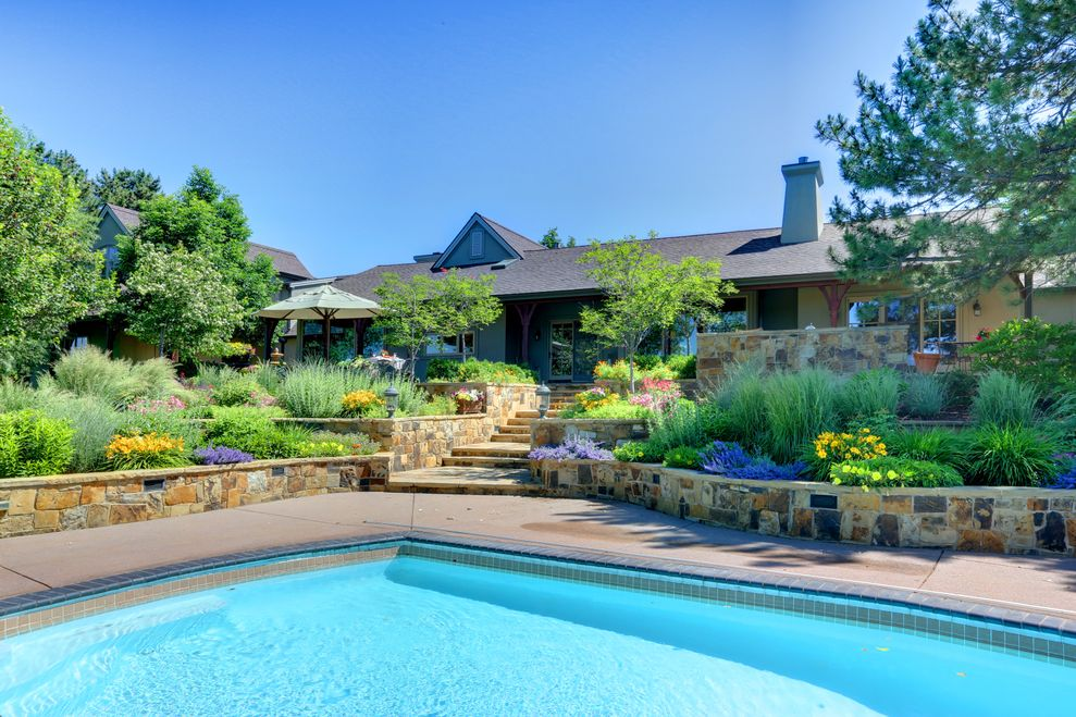 The home at 3010 E. Willamette Lane includes an in-ground pool. Photos courtesy of Kentwood Real Estate.