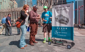 Employees roll the ads through 16th Street. (Courtesy of Chumba Media)