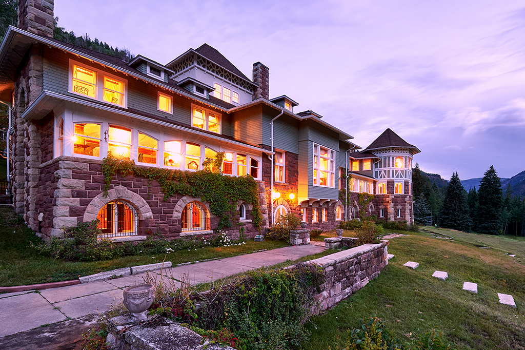 Redstone Castle includes a 23,000-square-foot main residence, a 12-stall carriage house and grounds totaling 150 acres. (Courtesy Platinum Luxury Auctions)