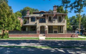 The four-story home at 992 South Franklin St. sits in a corner lot on the east side of Washington Park.