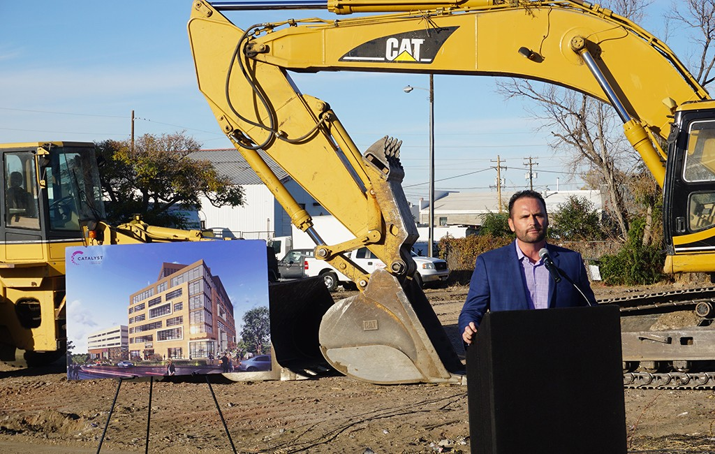 Mike Biselli speaks at the groundbreaking ceremony for the Catalyst building at the corner of 35th and Brighton. (Burl Rolett)