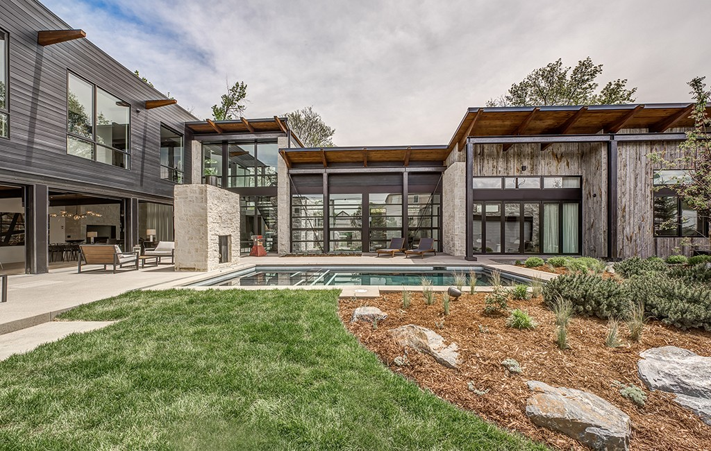 The Cherry Creek home includes a saltwater pool and hot tub, wooden steps climbing up a steel and glass stairway and a rooftop deck. (Courtesy LIV Sotheby's)