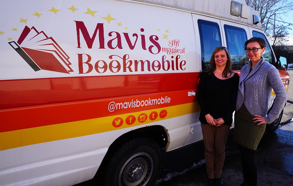 Nicole Sullivan, left, and Anna Kongs in front of the Book Moble. (Amy DiPierro)