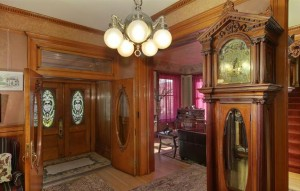 The entryway features a two-century-old mahogany grandfather clock that Adolph Zang imported from London. (Courtesy Distinctive Properties)